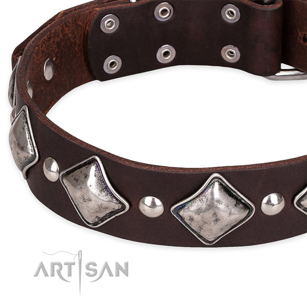 Adjustable leather dog collar with resistant to tear and wear non-rusting buckle